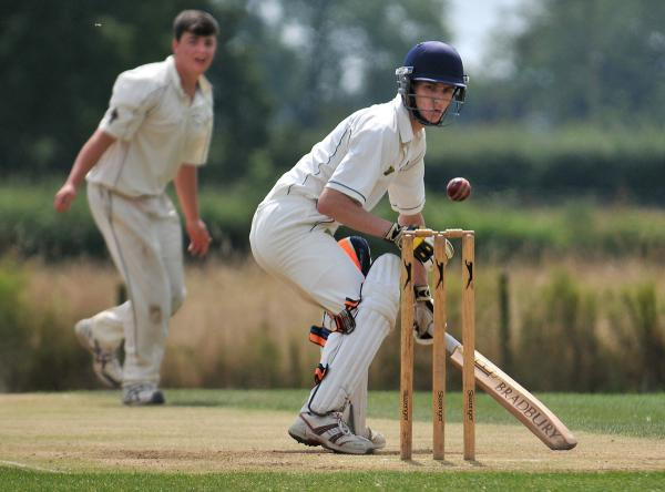 Sheriff Hutton's Joe Schofield watches the ball bounce over his wicket in the game against Duncombe