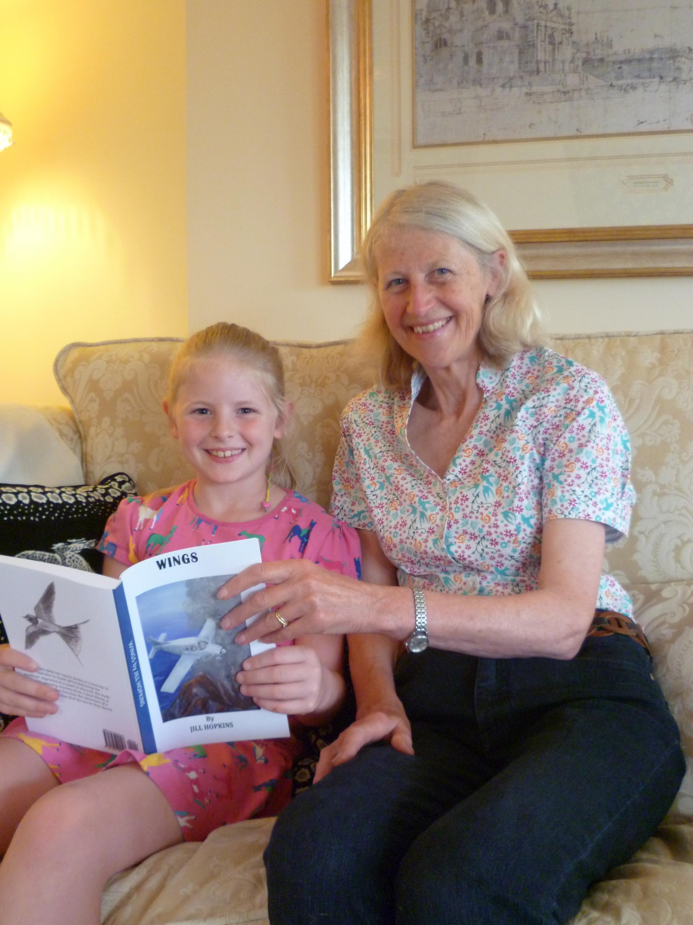 Author Jill Hopkins with eight-year-old Ellie Towse, a pupil at Norton Primary School, who was the first to read her new book, Wings