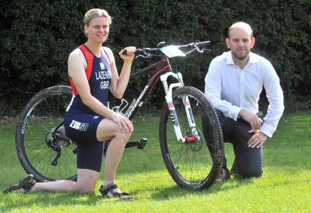 Triathlete Kathryn Lazenby with sponsor Chris Urwin.