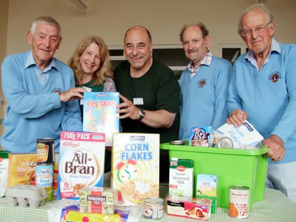 Foodbank manager John Mackenzie, centre, and volunteer Kath Tyler take delivery of donations from Ray Cordery, Geoff King and Neil Hardman
