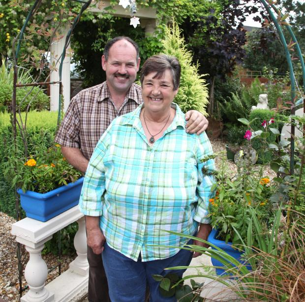 Jean Kavanagh and Callum Hallyburton in their garden, which won Pickering in Bloom's best large back garden category and the judges' special award