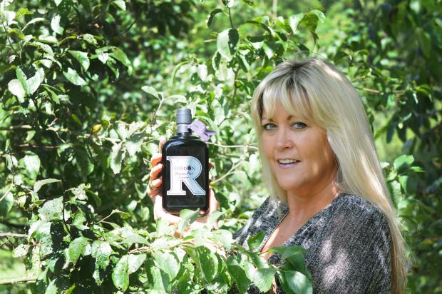 Julia Medforth, of Raithorpe Manor Fine Foods, with a bottle of the award-winning damson port