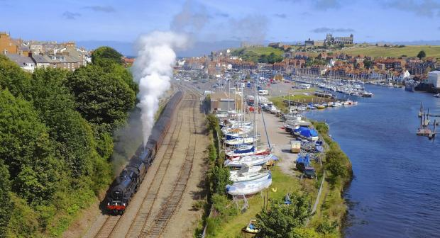 Steam locomotives No 45428 Eric Treacy and No 61264 pull a passenger train out of Whitby, where a secon passenger platform is now in use