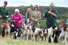 Left, Richard Aspery, Master of the Farndale Hunt, with the hounds and handlers;