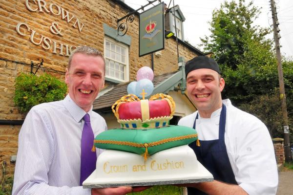 Guy Richardson, manager of the Crown and Cushion at Welburn, near Malton, head chef Matt Smith, and the celebratory cake