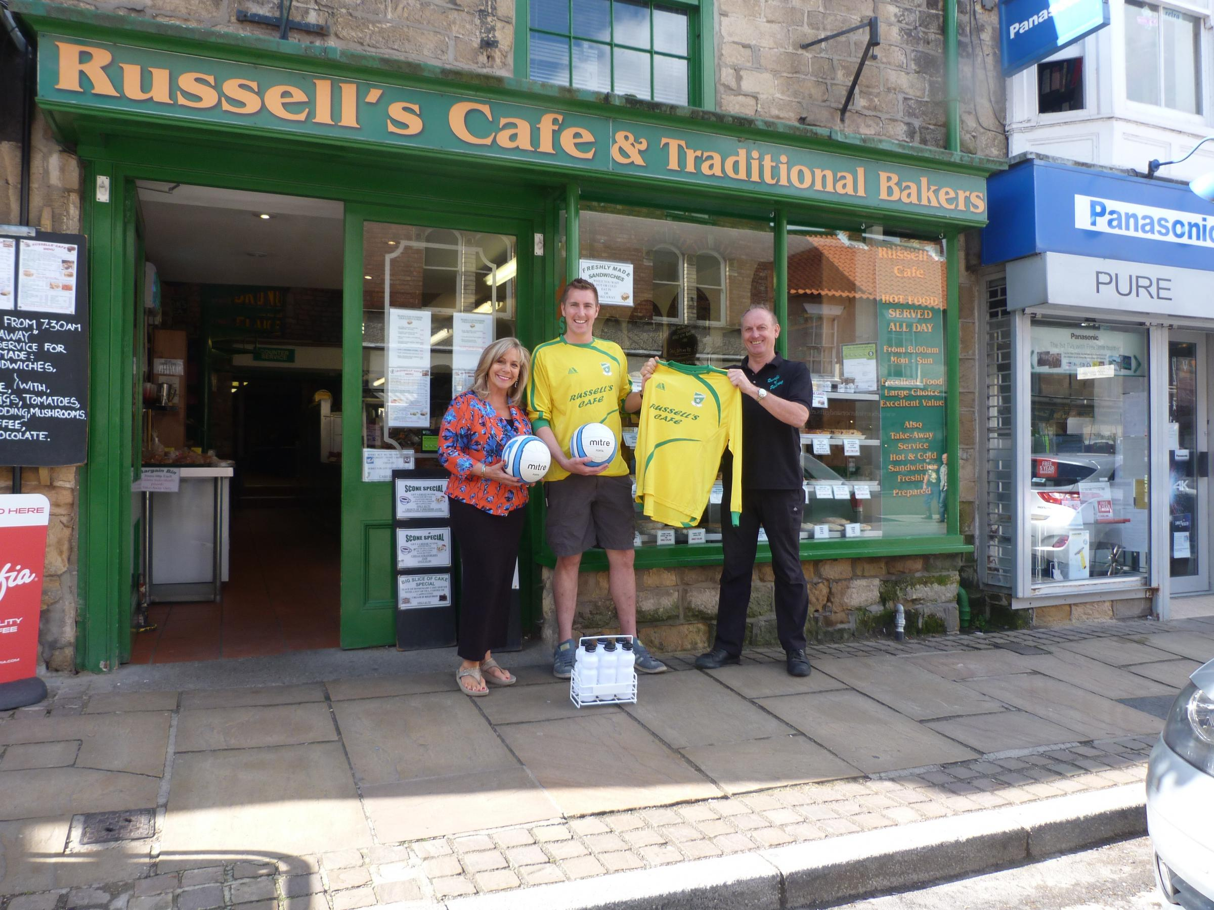 From left to right, training kit sponsor Barbara Leigh, Thornton-le-Dale first-team player-manager Danny Russell, and Gary Russell, owner of Russell's Cafe & Bakery of Pickering, the Thornton club's new first-team kit sponsor