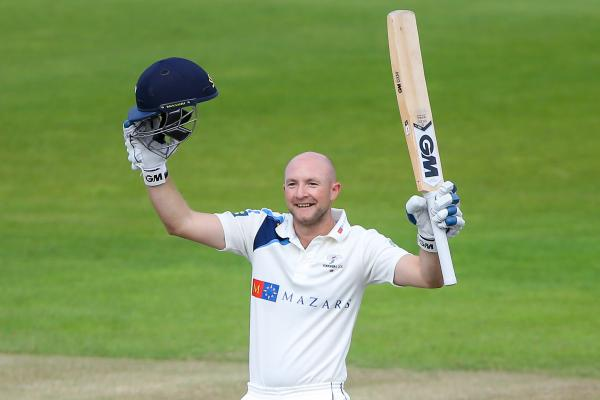 Yorkshire's Adam Lyth lifts his bat to the skies in celebration of his double century. Picture: Alex Whitehead/SWpix.com