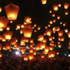 Gazette & Herald: Hundreds of Taiwanese people release sky lanterns in hopes of good fortune and prosperity in the Chinese new year before the traditional Lantern Festival in the Pingxi district of New Taipei City, Taiwan, Saturday, Feb. 8, 2014. The Lantern festival falls