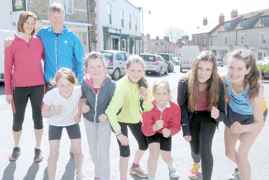 Kirkbymoorside 10k organisers Rick and Catherine Eve with some of the younger participants (from left) Ebony Simm, Evie Cass, Georgina Eve, Beth Cussons, Shannon Crossland and Harriet Eve.