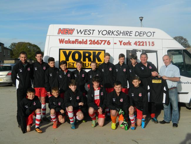Kirkbymoorside Under-14sin their new training jackets sponsored by Martin Ovenden