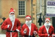 Philip Kreczac, Rob Davies and Catherine Tannahill in training for the Santa run