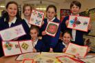 "Year 6 pupils at Norton Primary School with some of their artwork ""Journey around The World""."