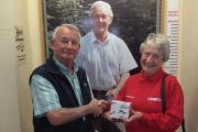 The World of James Herriot managing director Ian Ashton presents a farewell gift to long-serving volunteer Pauline Pengelly