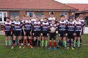 Malton & Norton Under-13s in kit emblazoned with their new shirt sponsors - Derventio Barkery, of Malton, and Ian Britton Photography, of Pickering