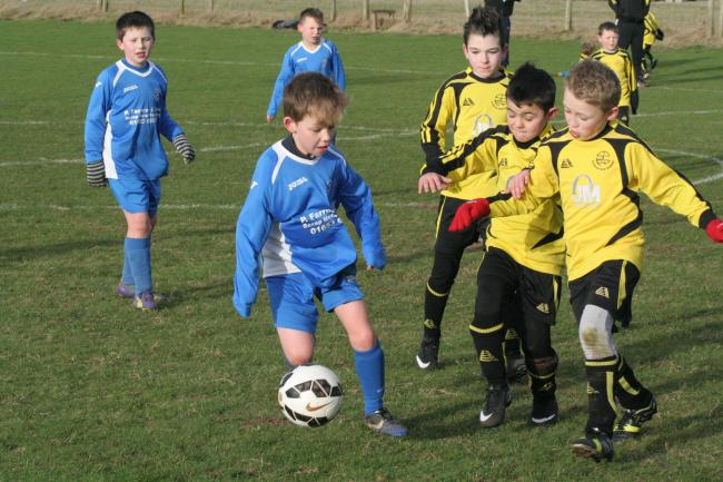 Action from Heslerton Under-9s' match against Scholes Park Raiders