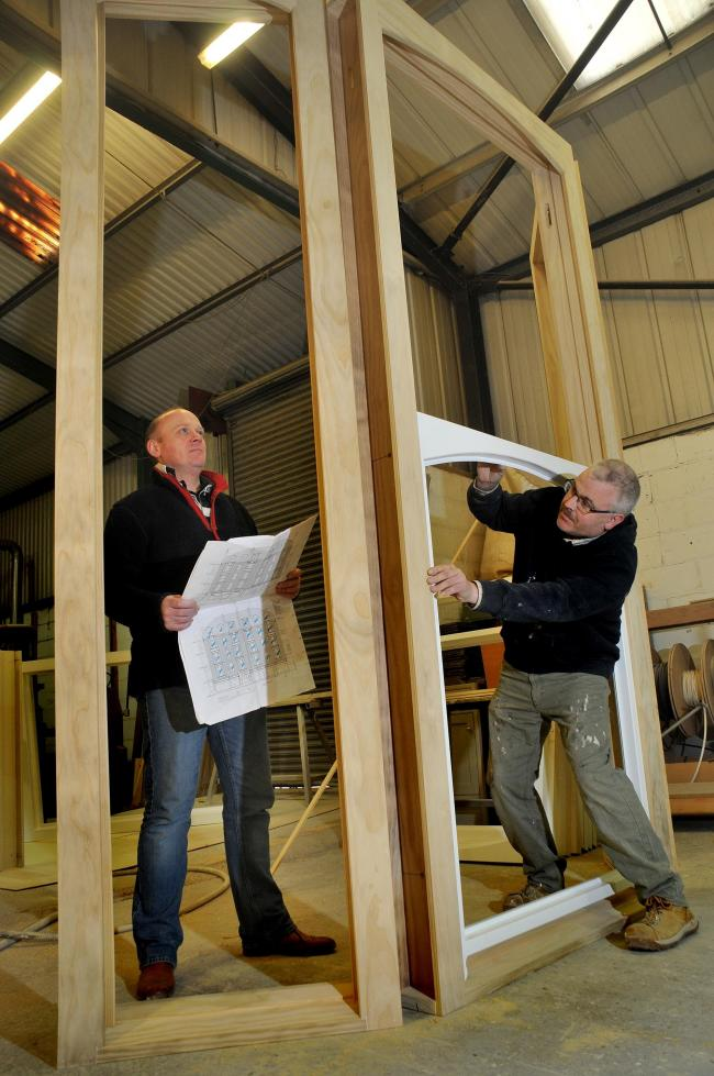 David Hume, left, and Adrian Saul, of Derwent Vale Building Services, Malton, with one of the windows they are making for the project in Scarborough