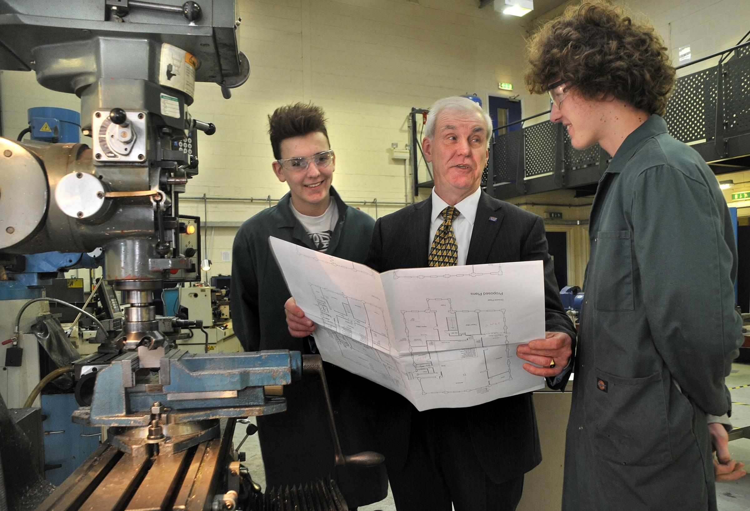John Brockett, of Derwent Training, shows Dale Power Solutions trainees Alistair Potter, left, and Will Wilkinson, right, about its expansion plans