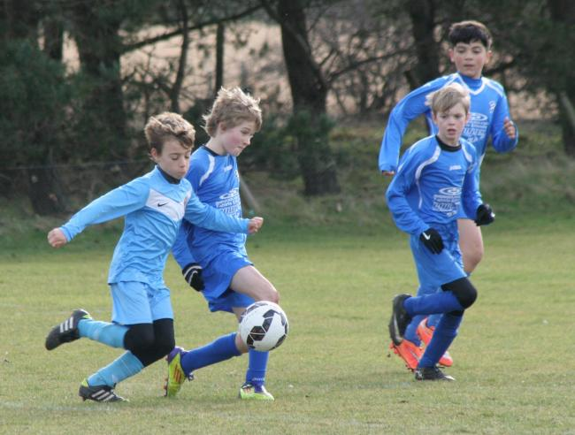 Action from Heslerton Under-11s' match against Whitby Fisherman