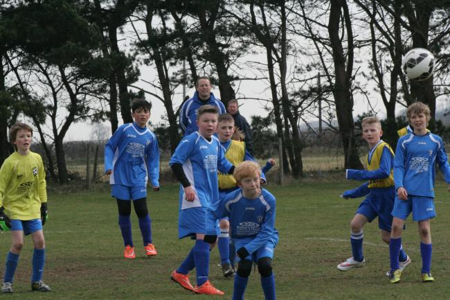 Heslerton Under-11s defend a corner during the Scarbor-ough & District League match against Seamer