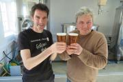 CHEERS: Malcolm Hodgson (left) and Kyle Boote toast the new brew.