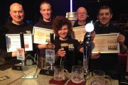 Staff at Brass Castle Brewery celebrate being awarded the Supreme Champion Beer of the UK