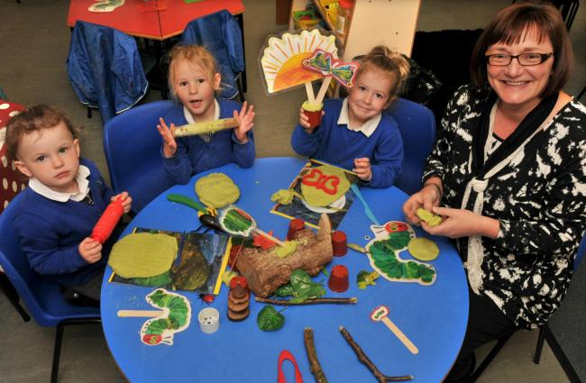 Teaching assistant Joanne Clegg with some of the three-year-old pupils who are now welcome at Luttons Primary School