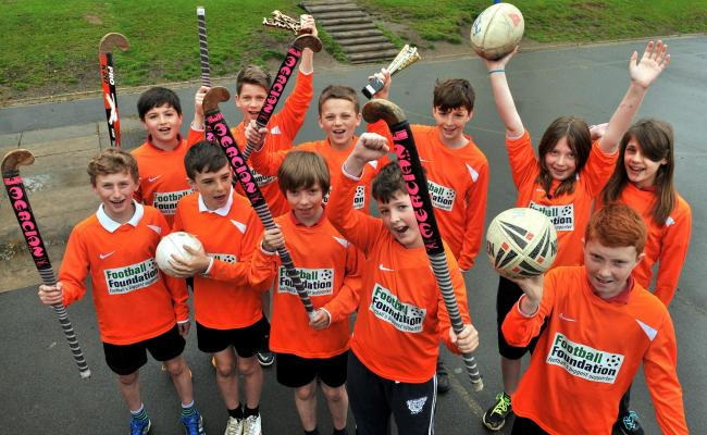 Pupils at Kirkbymoorside Primary School celebrate their recent success at hockey and tag rugby