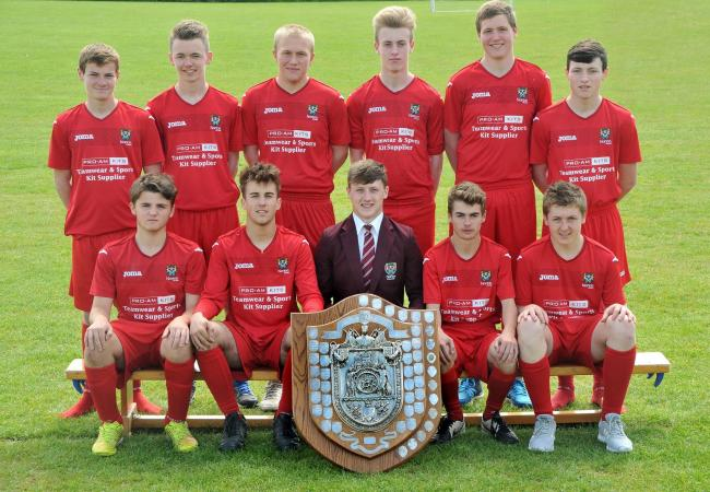 Norton College Year 11 football team with the trophy they won. Front, from left, Josh Ford, Harvey Townley, Bradley Freer, Baron Gregory and Jack Boyd. Back row, Connor Pickering, Robbie Butler, Nick Lock, Iain Kerr, Will Hughes and Josh Towse