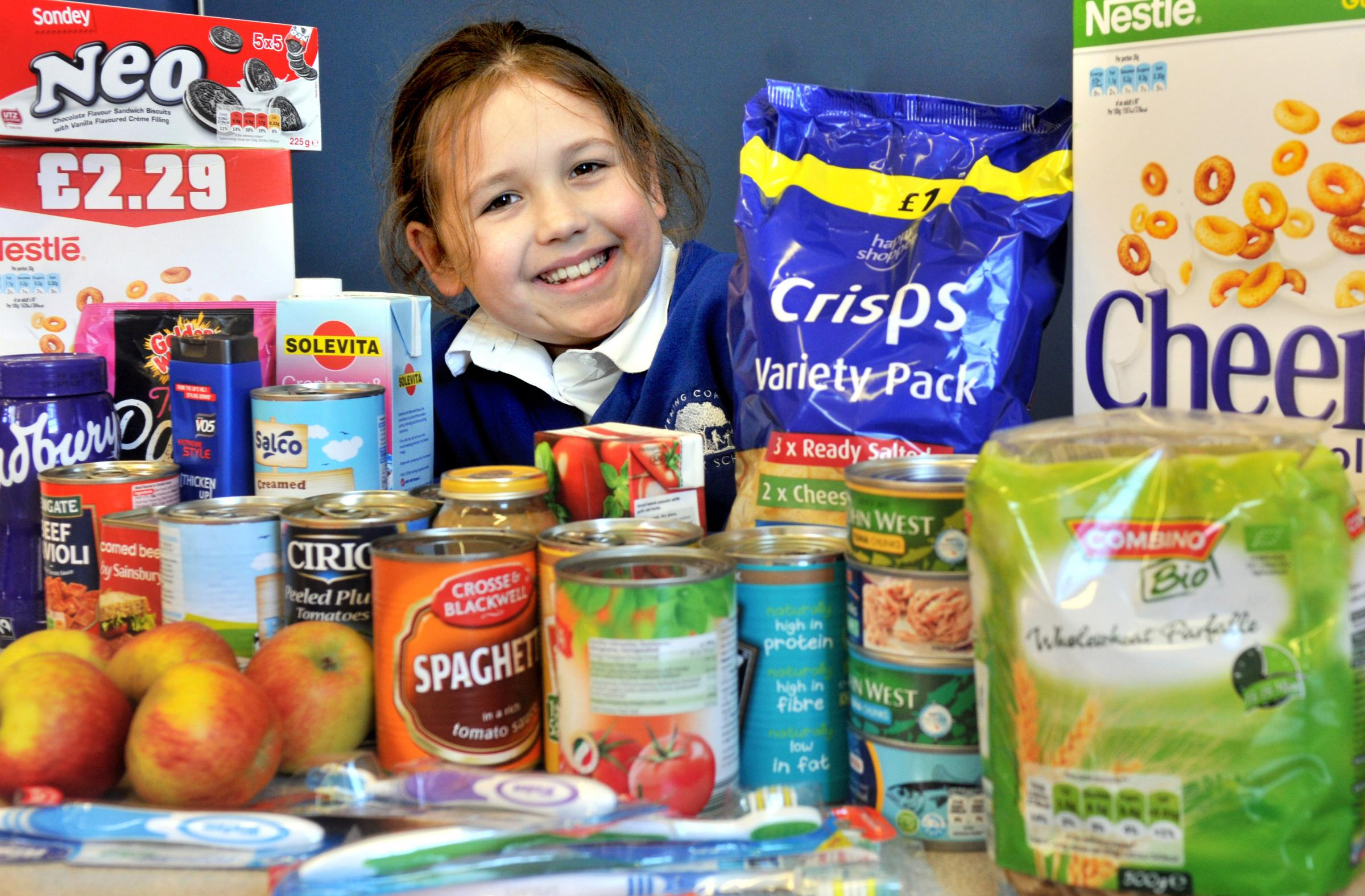 India Collier-Hield with some of the food collected at Leavening Primary School to be donated to the Ryedale Foodbank. Picture: Nigel Holland