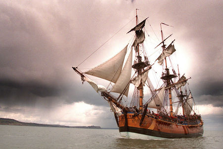 A replica of HMS Endeavour sailing off the Yorkshire coast