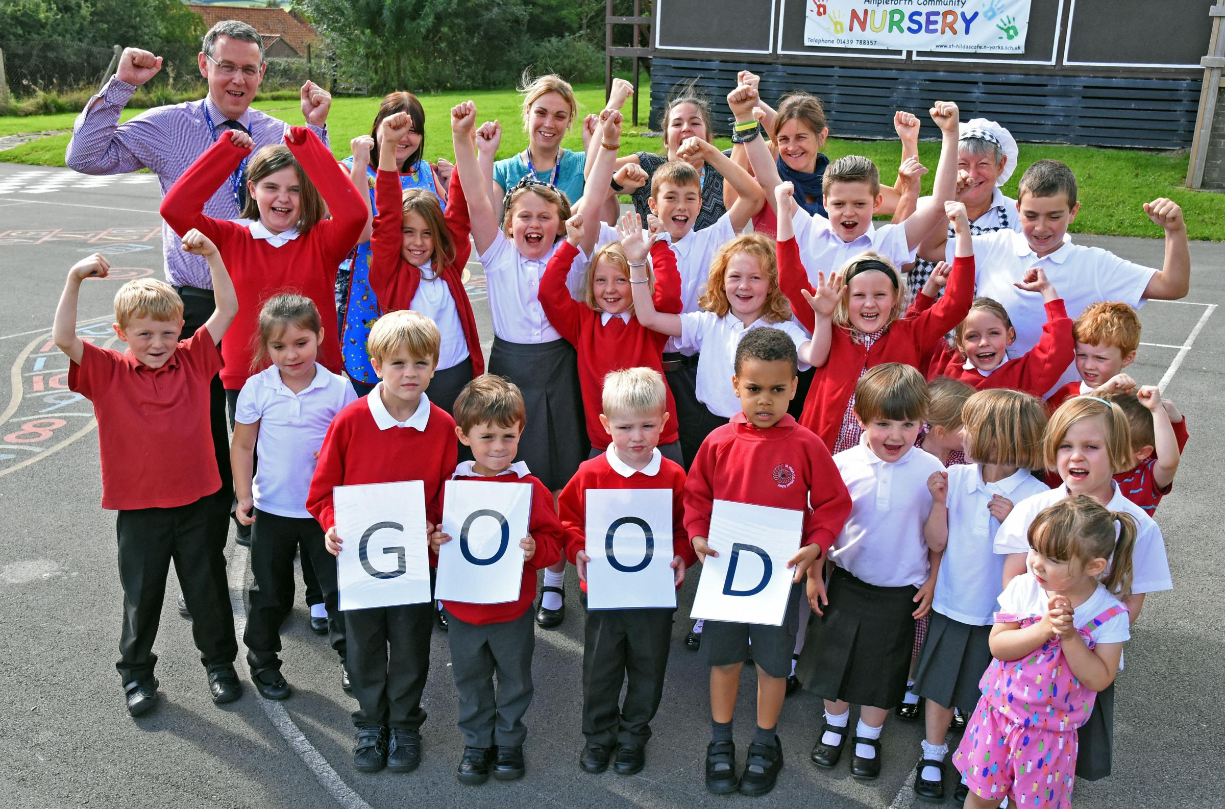 GOOD: Head teacher James Pynn and pupils at St Hilda's Ampleforth celebrate their Ofsted Report  Picture: Nigel Holland