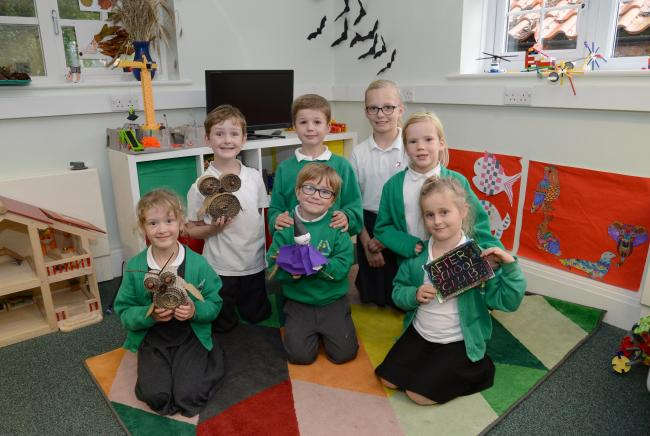 Gwennie Holmes, Robert Cogger, Oliver Simpson, Jacob Rogers, Verity Burbridge-Ring, Josie Hoste and Rosa Gehrels help promote the after-school club at Langton Primary School      Picture: Anna Gowthorpe