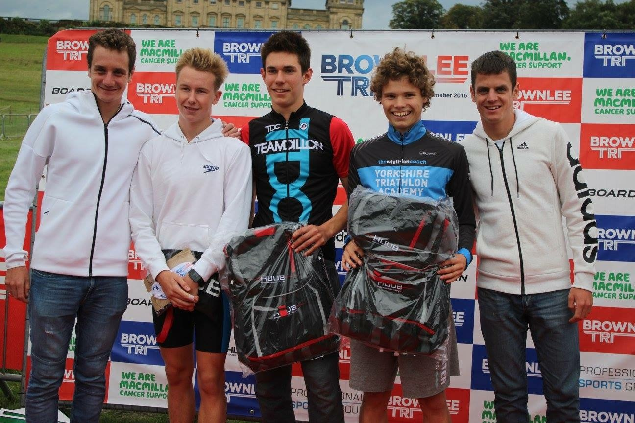 SUCCESS: Ryedale triathlete Tyler Hutchinson (second from right) pictured with Great Britain's Olympic heroes Alistair Brownlee (far left) and Jonny Brownlee (far right) after winning the Brownlee Triathlon junior event.