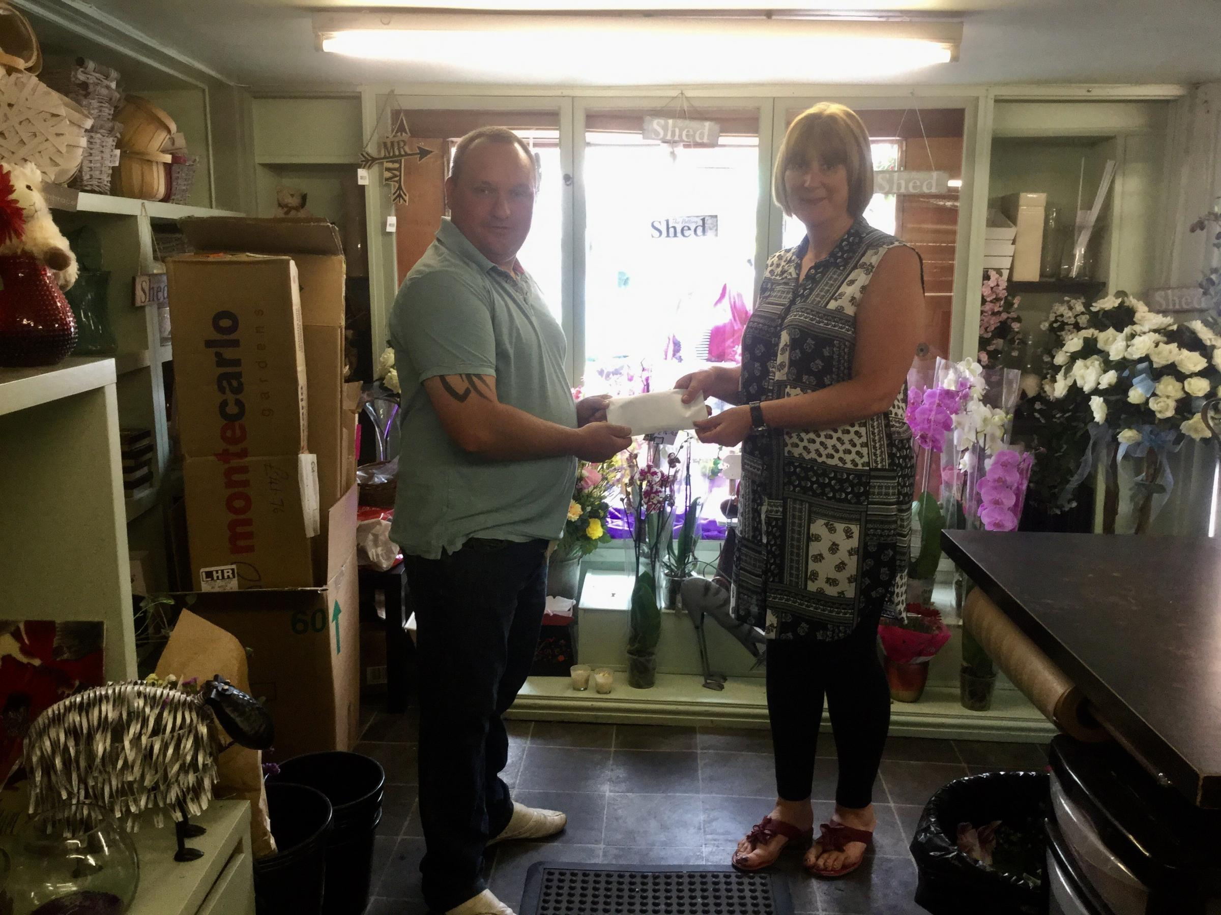 Dan Carriss handing a donation of £750 pounds to Rebecca Render, chairman of the Malton Hospital League of Friends