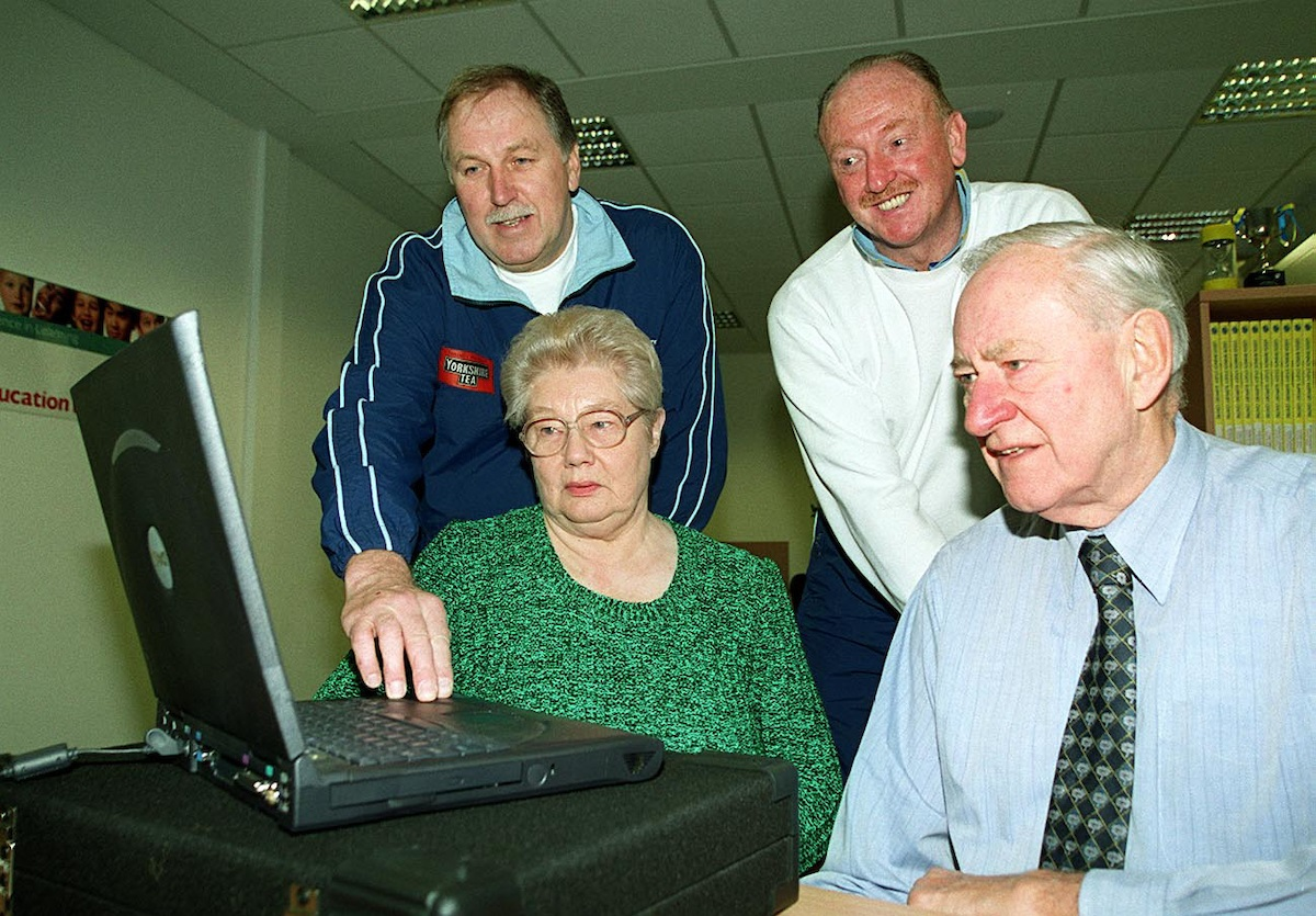 Geoff Holmes, right, and Vivien Stone, who worked on the second-hand bookstall at Headingley, with video training equipment that they bought for Yorkshire County Cricket Club, watched by coaches Steve Oldham and Arnie Sidebottom Picture: Simon/SWpix.com