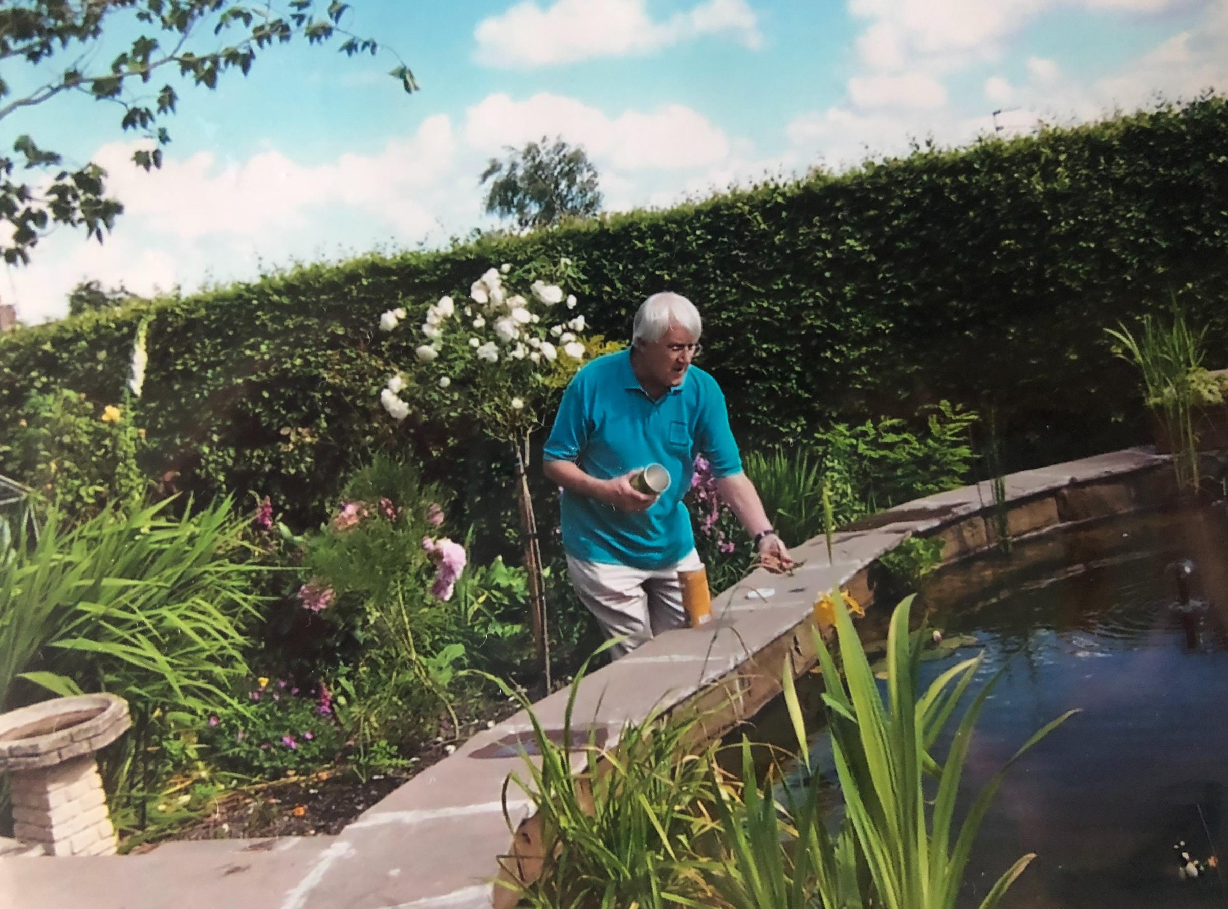 Peter Walker feeding the fish in his own pond a couple of years ago