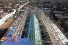 Scaffolders at work above the roof of Chichester Cathedral in West Sussex (Gareth Fuller/PA)