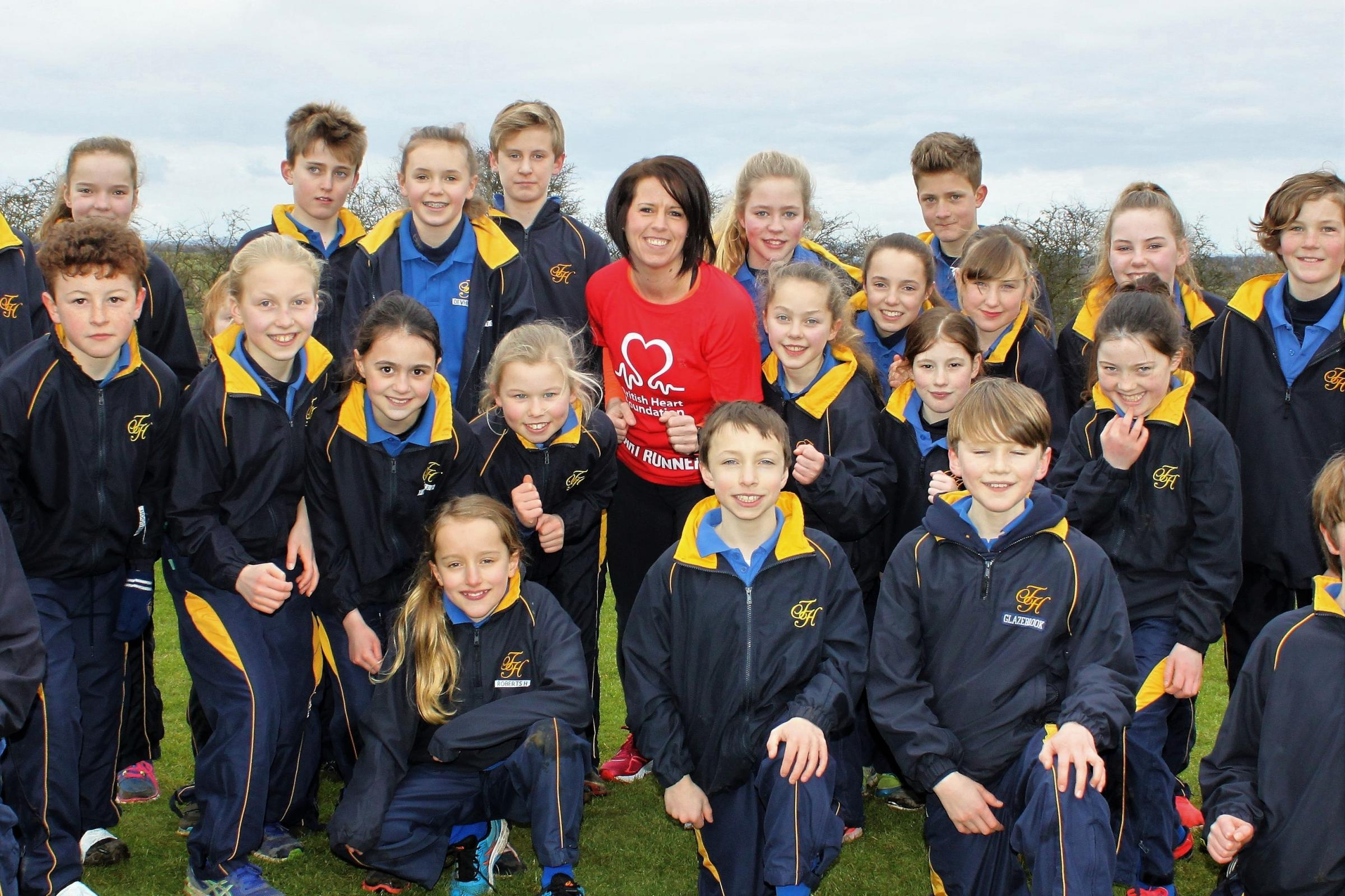 Paula Edgar lines-up with Terrington Hall runners as she gets ready for to take part in her first London Marathon in April in aid of the British Heart Foundation