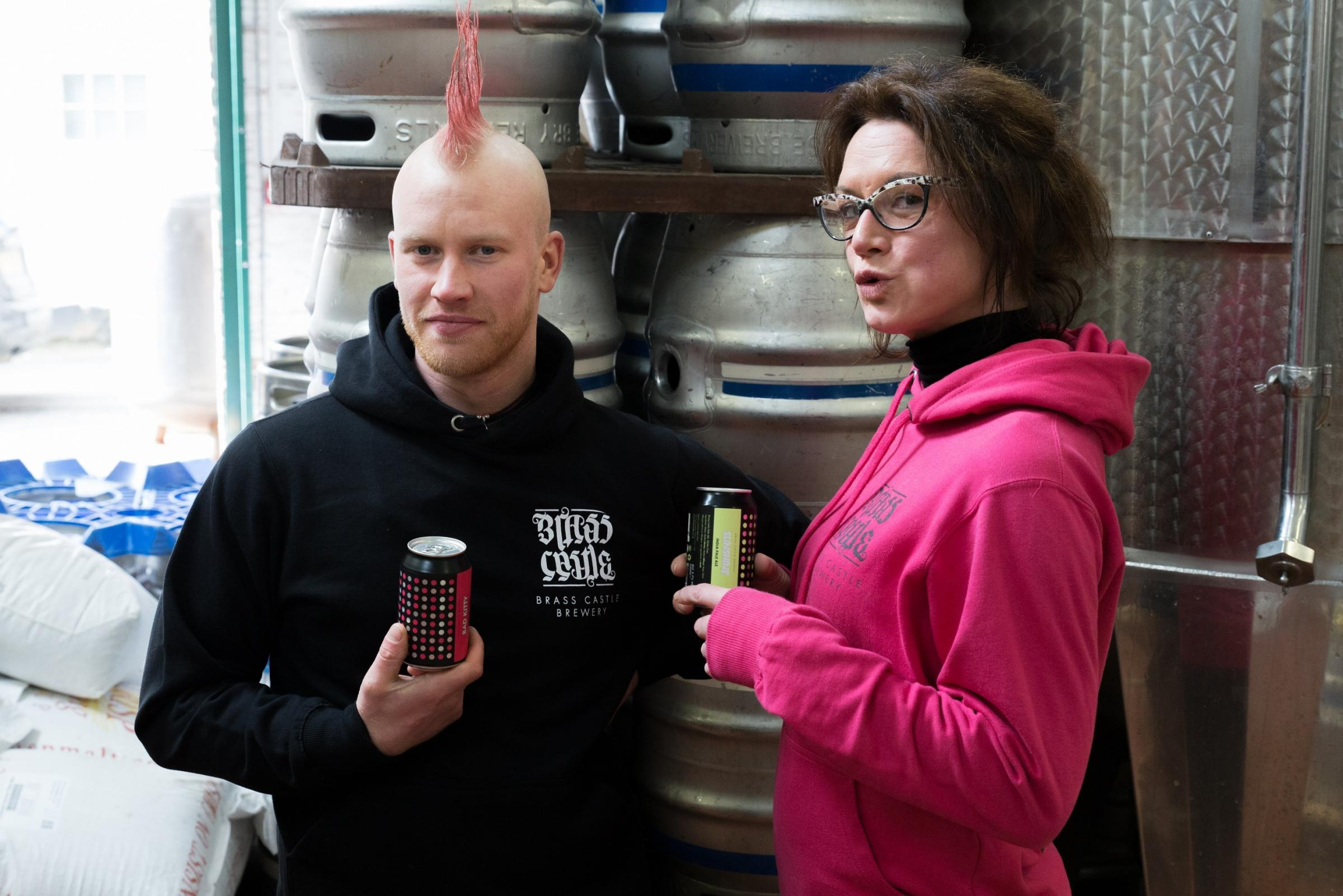 Brewer Sam Teale and marketing manager Amy Pulling at Brass Castle Brewery in Malton, with cans of Bad Kitty and Sunshine IPA