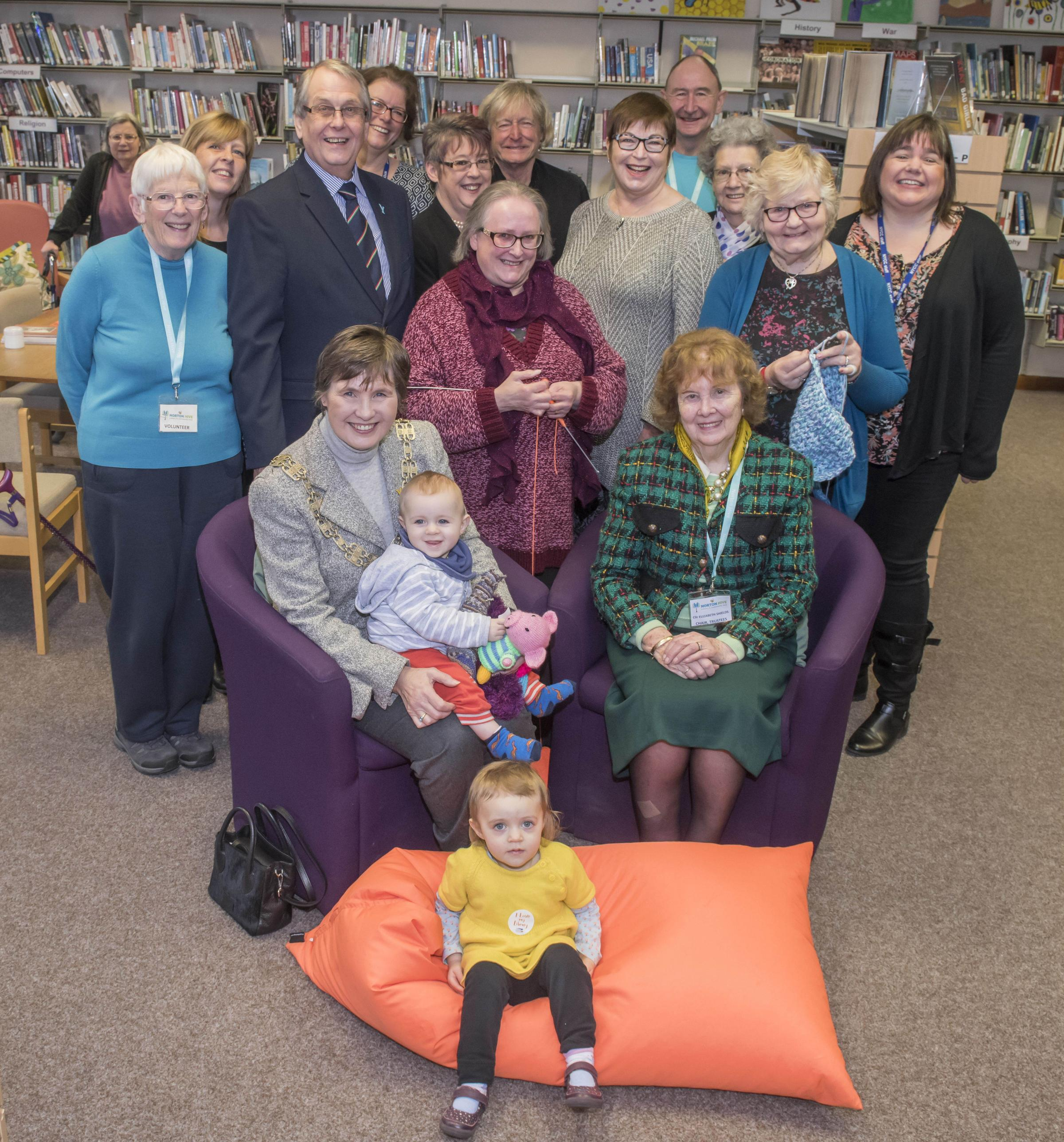 Cllr Helen Swier, seated, left, and Cllr Elizabeth Shields, seated, right, celebrate the success of Norton Hive Library and Community Hub with volunteers, councillors and members of the Stronger Communities team