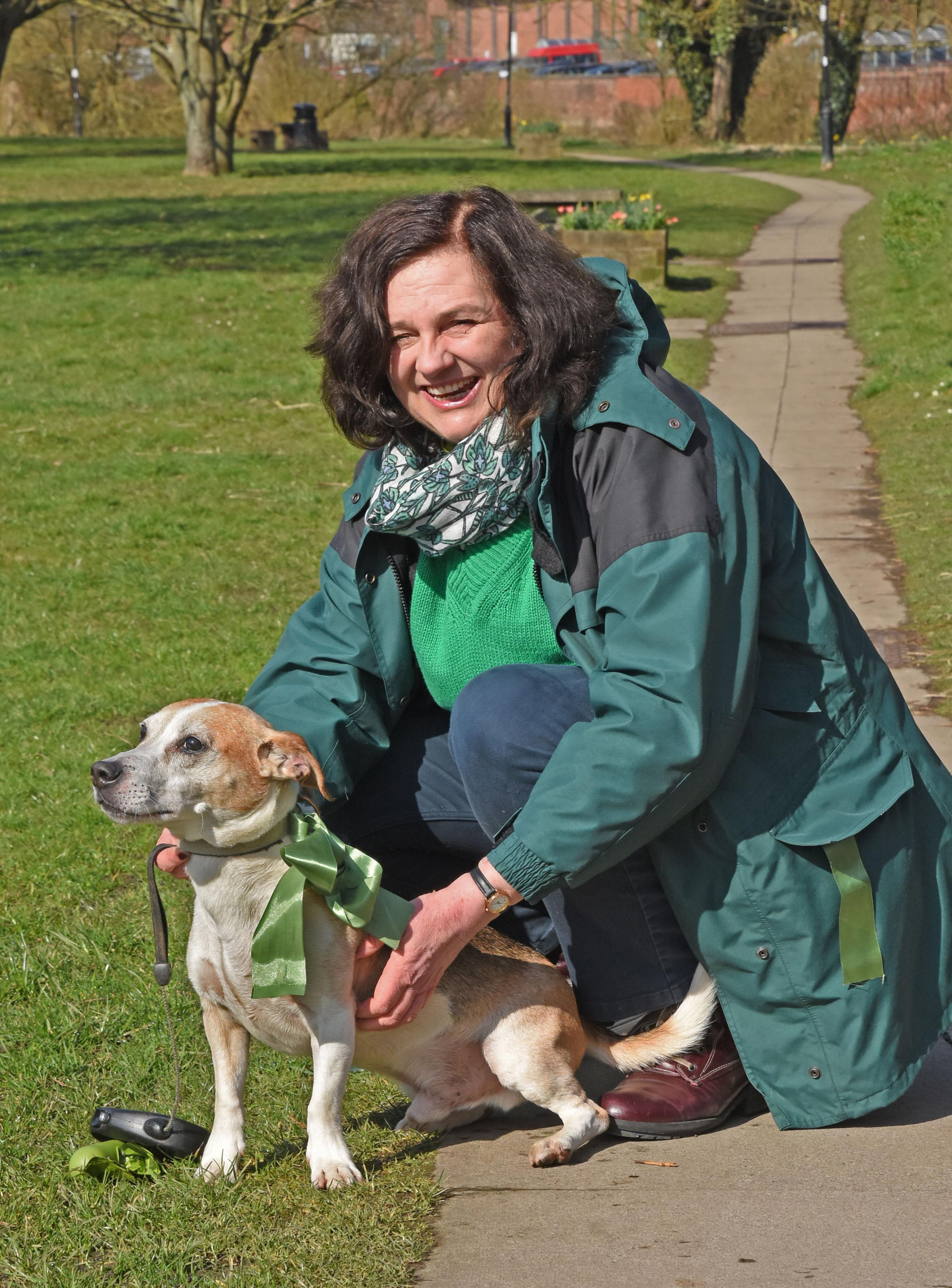 Cllr Di Keal with her dog Bertie wearing a green ribbon