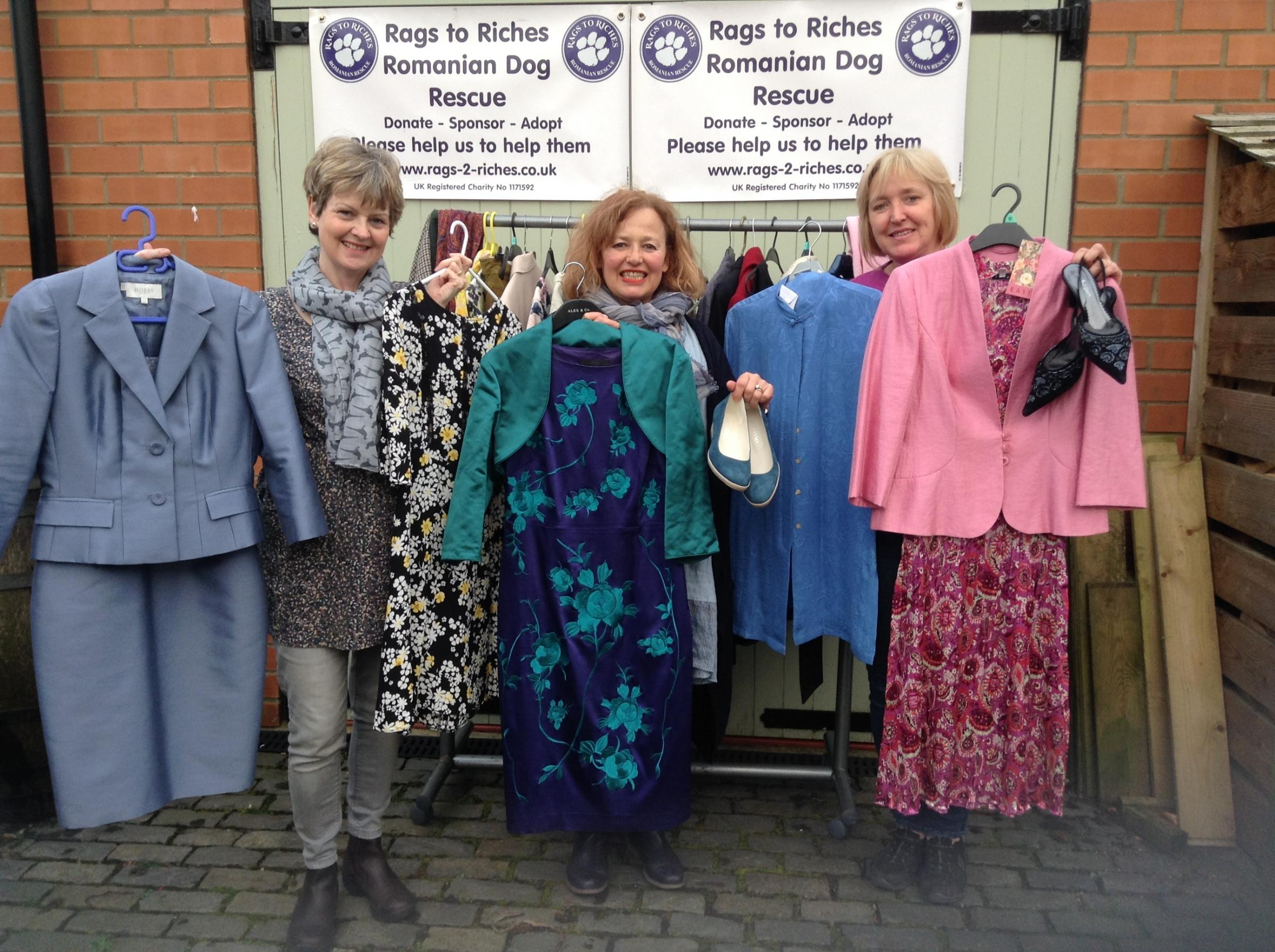 Getting ready for a preloved ladies clothing and accessories sale are fundraisers l-r Mandy Newlove, Dawn Panas and Helen Knapp.