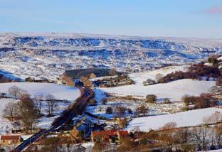 A small settlement exists at Dale Head, Rosedale, with the impressive Blakey Rigg behind.
