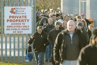 Gazette & Herald: Workers leave Malton Bacon Factory after yesterday's announcement.