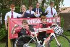 Looking forward to the Ryedale Rumble cycling event are  Ryedale School students Toby Antcliff and Freddie Singleton, front, with Henry Singleton, Lizzie Coutts the event director, Herbert Antcliff, Head teacher Mark McCandless and Marcus Gatenby