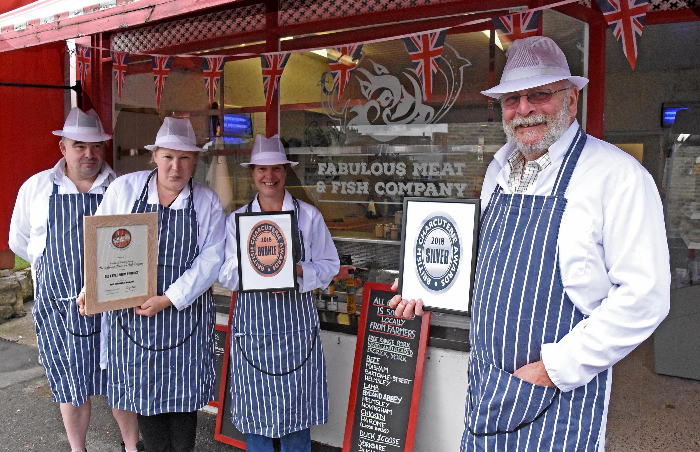 Alan Goodwill, right, and staff members Gary Benson, Sarah Wayper and Amanda Goodwill with their bronze and silver awards at the Fabulous Meat and Fish Company, which recently took over a butcher's shop in Helmsley    Picture: Nigel Holland
