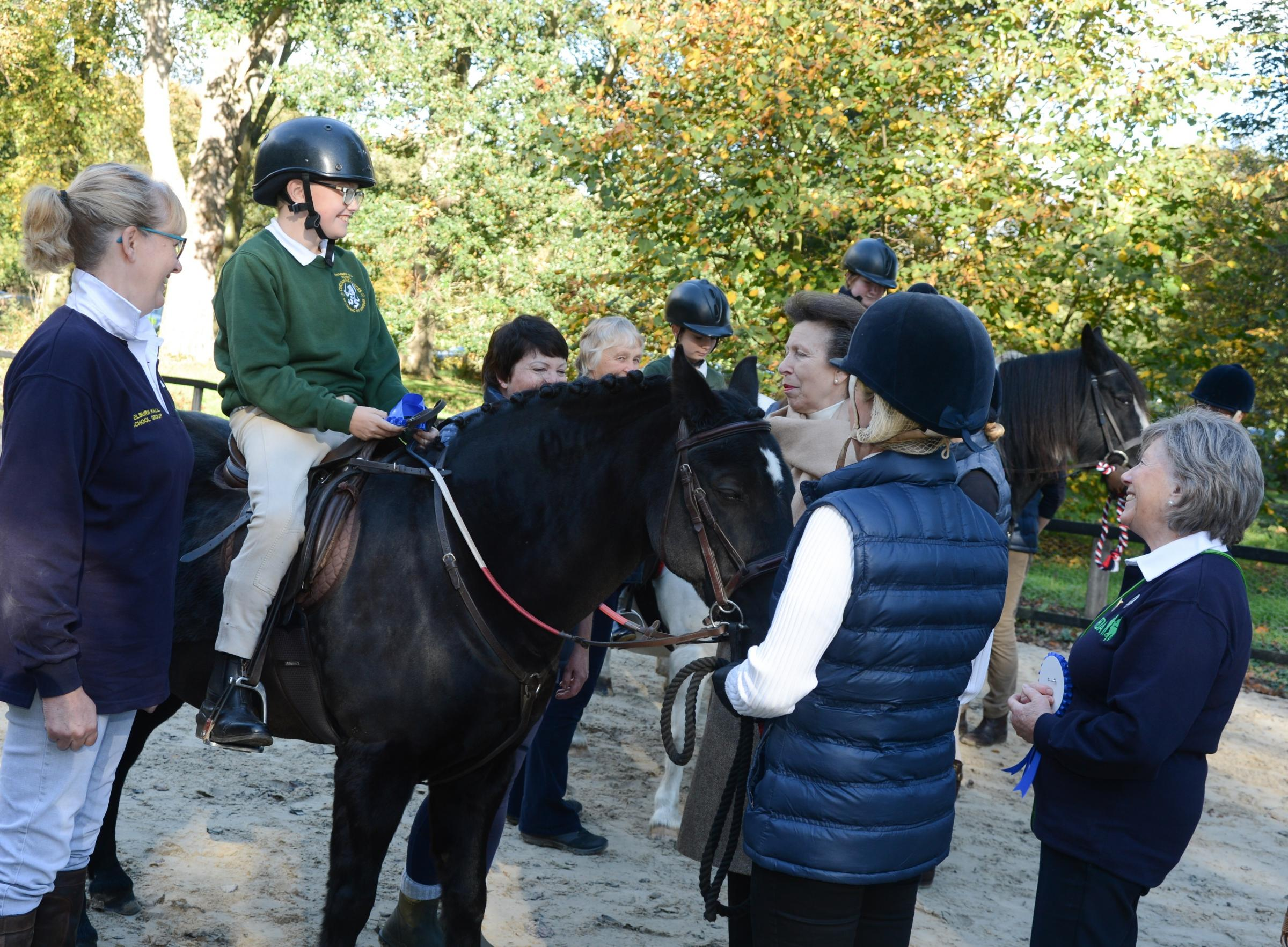 Princess Anne presenting a rosette to Daniel Price riding Dennis during her visit last weekendPicture: Welburn Hall School Riding Group