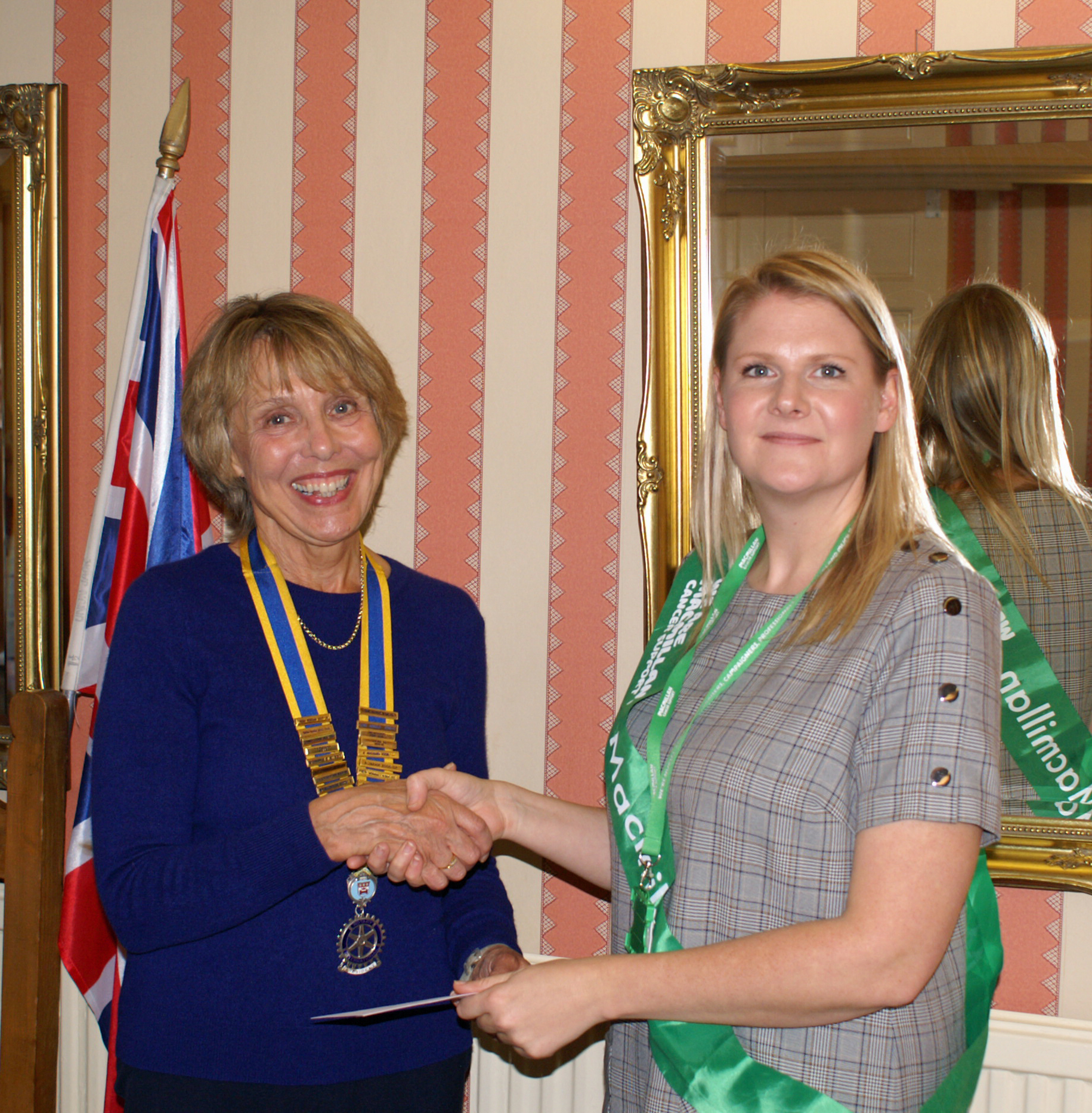 President of Pickering and District Rotary Club Sue Harris hands over a cheque for £700 to Clara White, from Macmillan Cancer Support