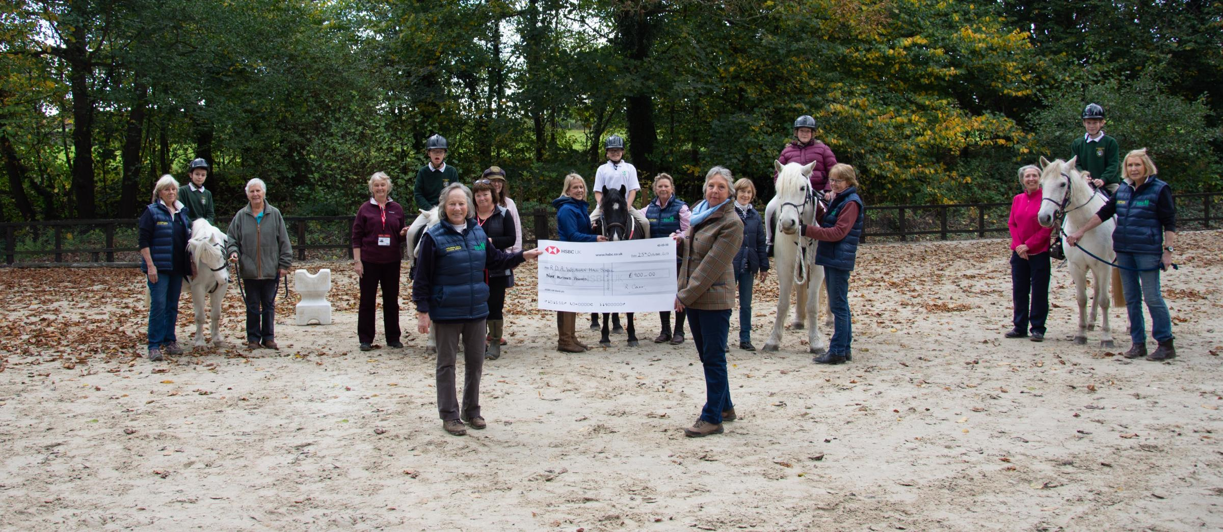 The presentation of a cheque for £900 to Riding for the Disabled at Welburn Hall School, presented on behalf of The Ladies' Section of Kirkbymoorside Golf Club