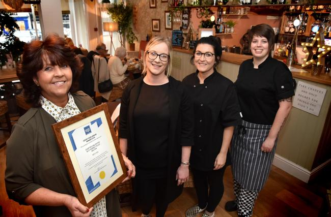 Staff at Chapter One Bistro in Malton's Market Place celebrate after receiving a Good Food Award for 2019, from left, Jackie Scott, Zoe Glover, Becky Gill and Siobhan Quinn                                                              Picture: Frank